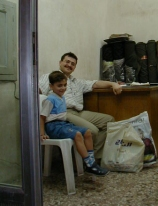 Dad and son in suq shop